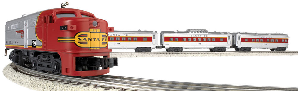 O gauge passenger train with cars coming around a curve