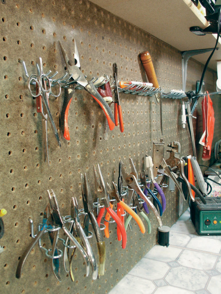 Hand tools within reach of a work bench.