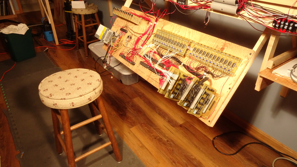 Multiple printed-circuit boards and other electronic devices are mounted on a plywood sheet and connected with wiring