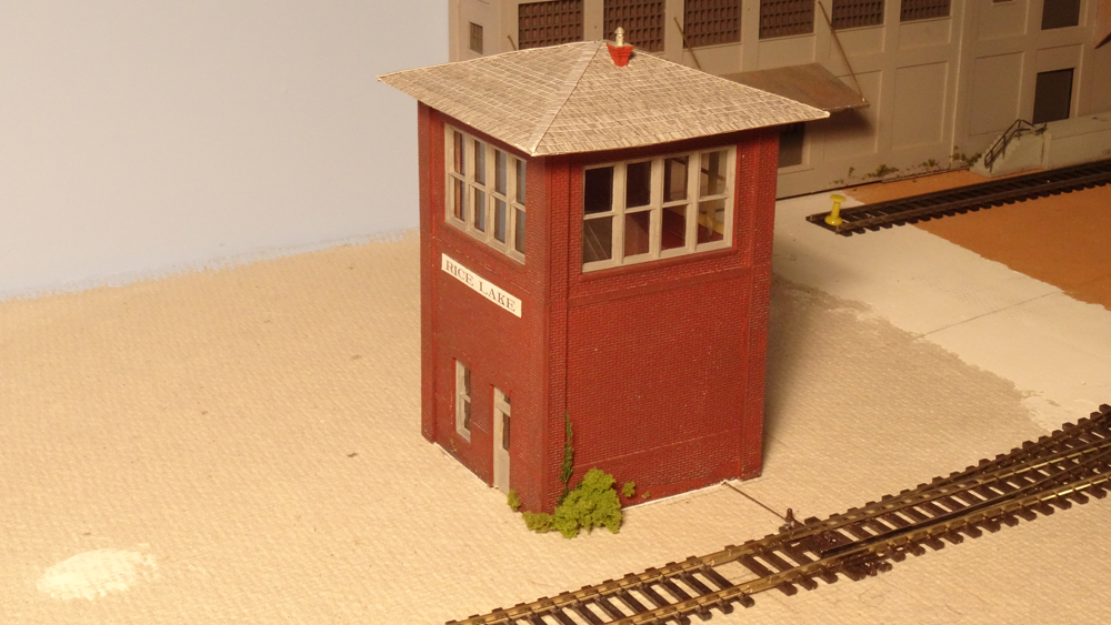 An HO scale model of an interlocking tower conceals the servo seen in the previous photo.