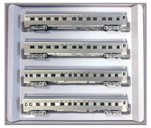 Four passenger cars in packaging