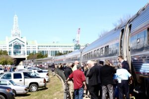 Train stopped while a crowd stands beside it