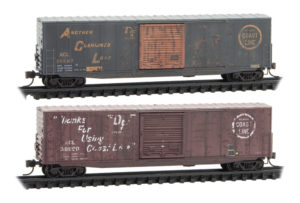 Two weather boxcars