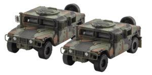 Camouflage colored Humvee trucks