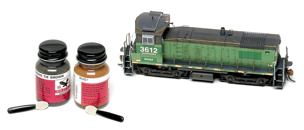 Athearn HO scale SW1000 weathered with acrylic hobby paints and makeup applicators.