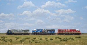 three locomotives in a row on tracks