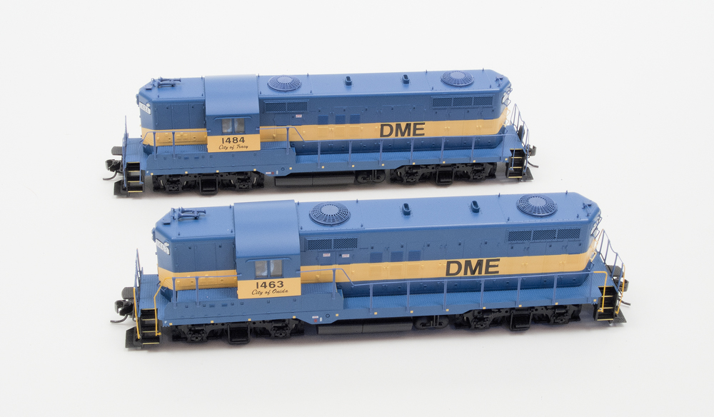 Walthers HO scale Electro-Motive Division GP9s with (foreground) and without vertical handrails painted yellow