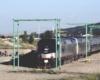Amtrak train parked on a siding.