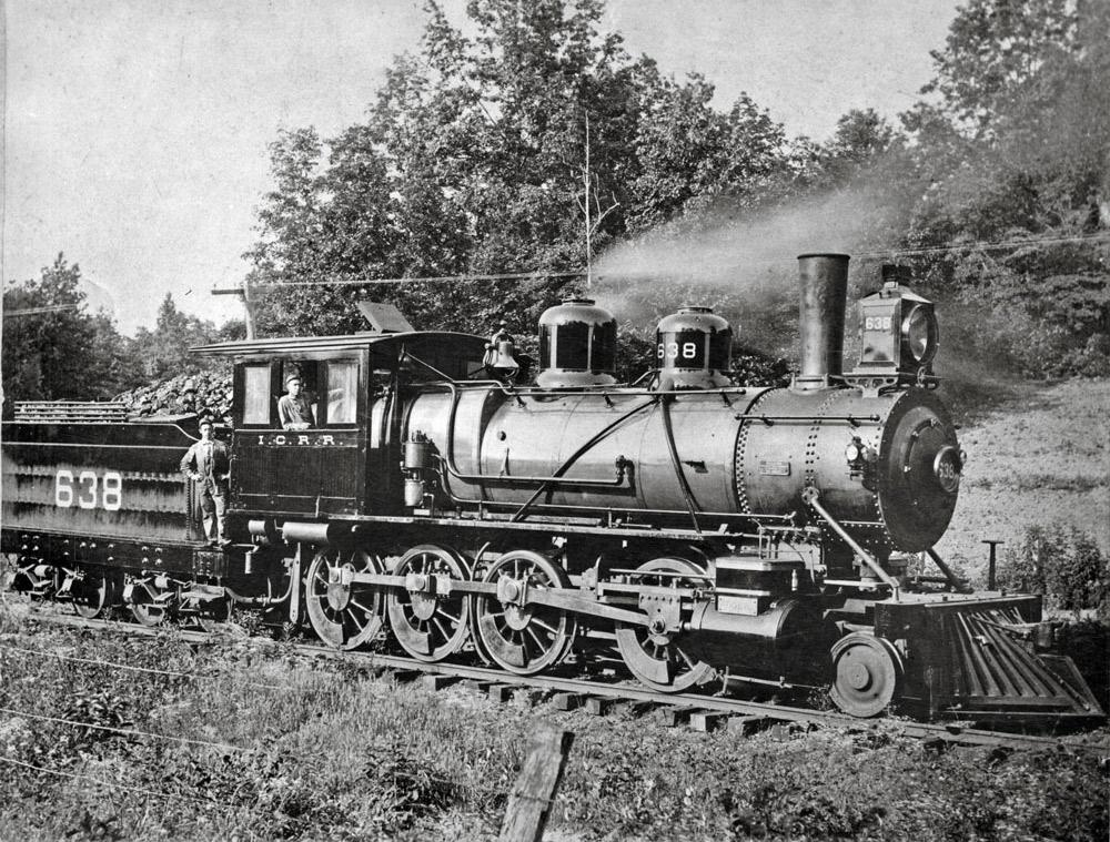 Engineer and fireman on steam locomotive