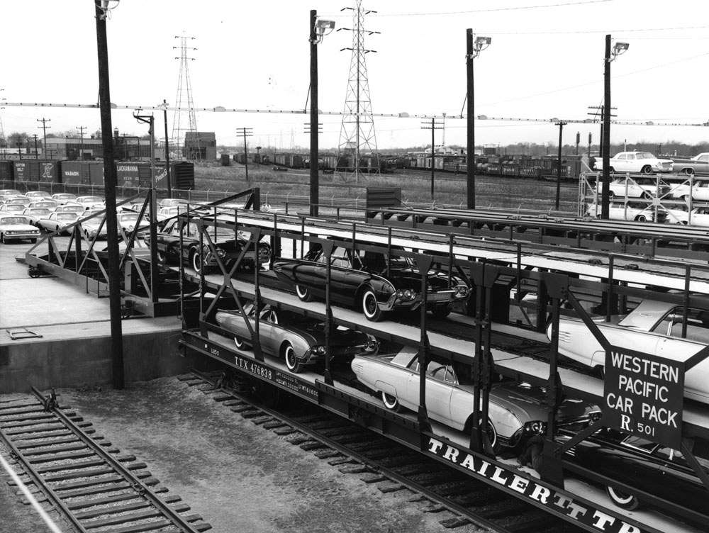 Automobiles being loaded on tri-level freight cars