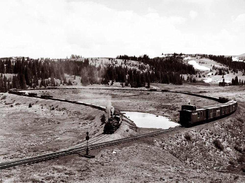 Narrow-gauge freight train on horseshoe curve