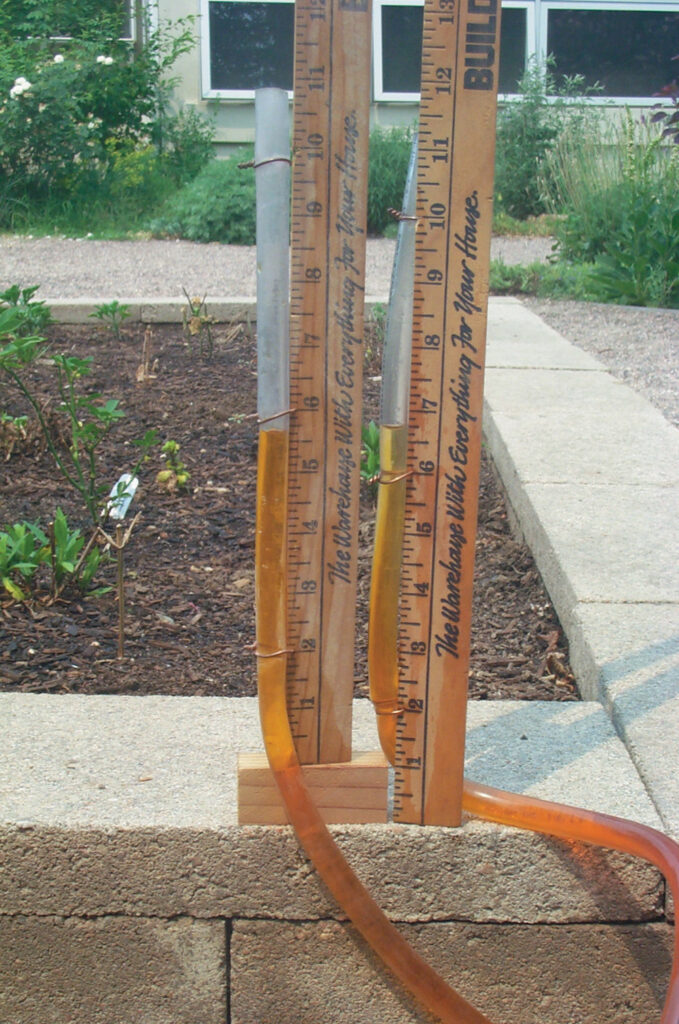 Homemade water level, one side raised one inch to show elevation change.