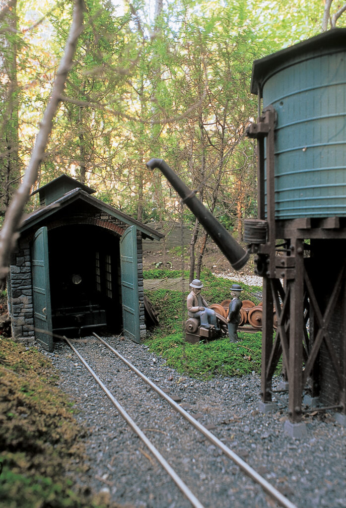 Custom-built storage shed and water tower on Jim Strong's Woodland Railway