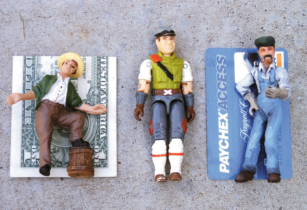 Large-scale figures posed next to dollar bills to determine scale