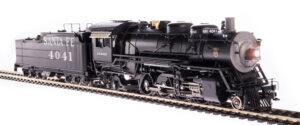 Steam locomotive pulling a coal car