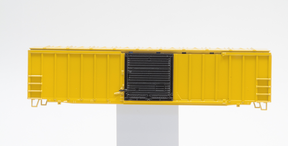Yellow boxcar with black door after Clear Gloss finish has been applied.