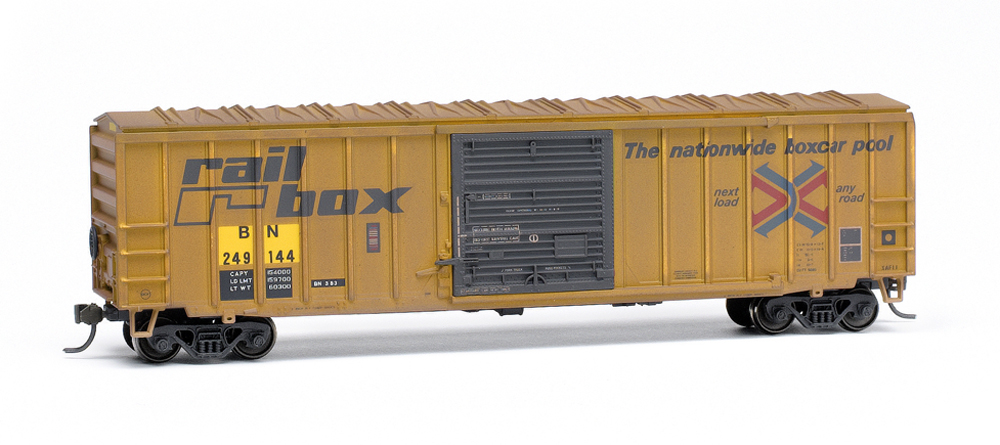 Weathered HO scale Railbox 50-foot sliding-door boxcar with Burlington Northern reporting marks.