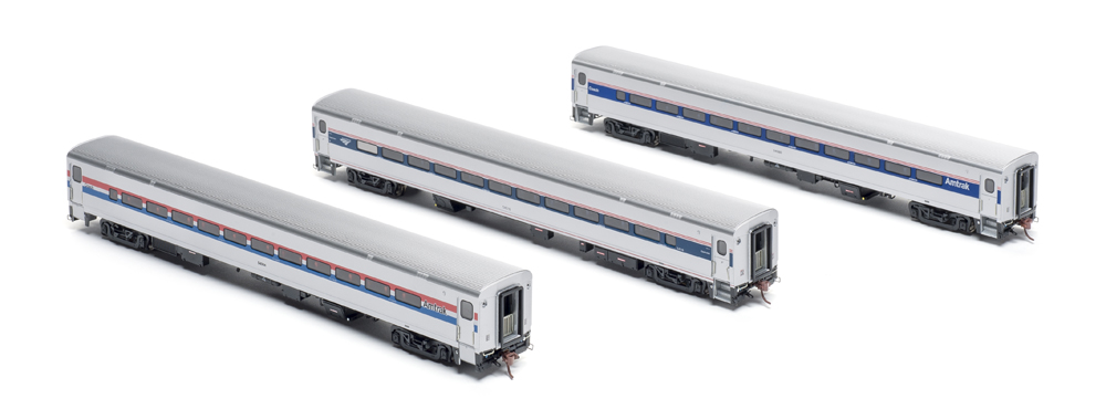 Three Amtrak passenger cars