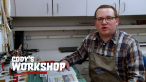 Cody Grivno sitting at his workbench in the opening shot of Cody's Workshop Episode 44