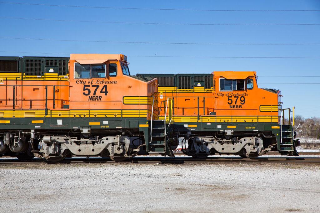 Orange locomotive cabs side by side