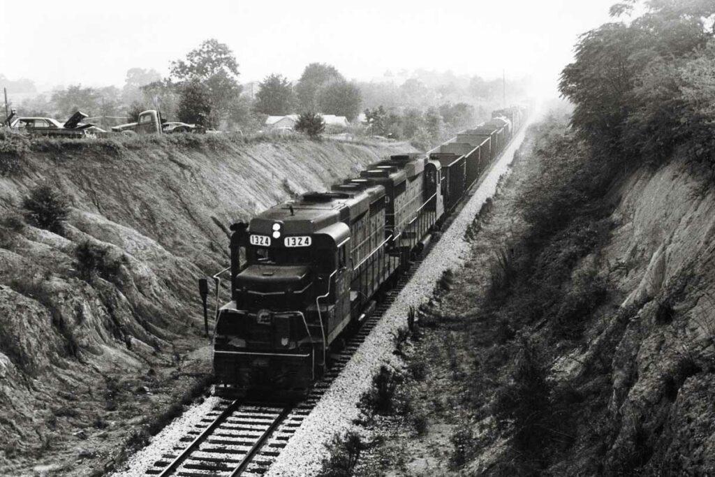 Diesel locomotives on coal train in cut