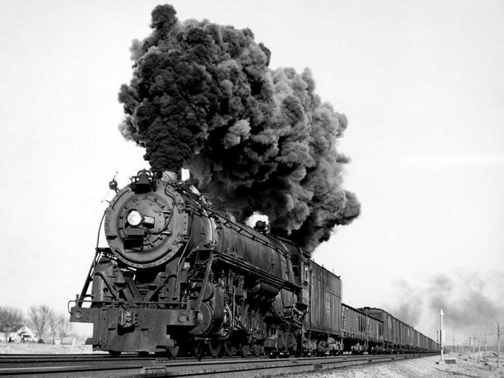 Steam locomotive smoking with freight train