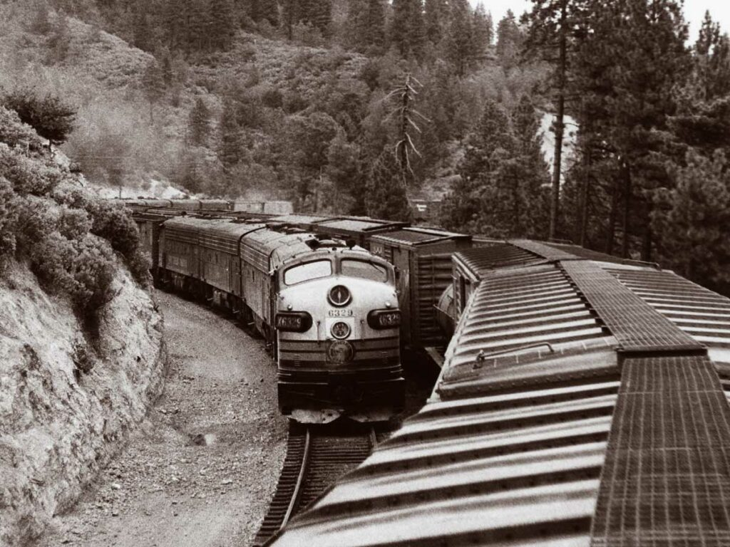 Freight trains pass on mountainside
