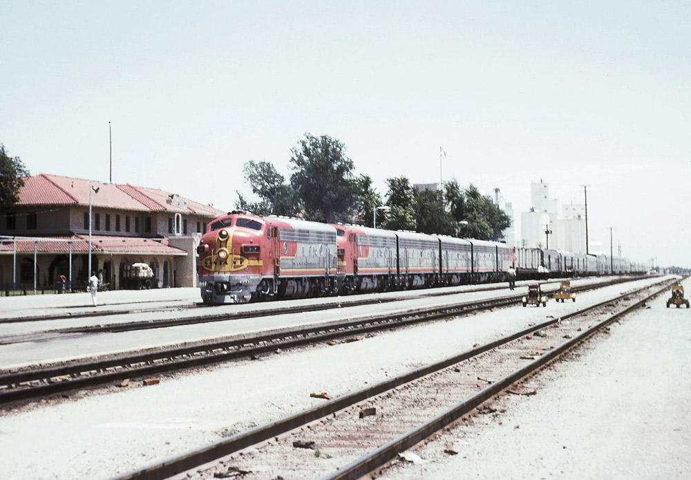 Rear view of motor passenger train at station