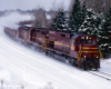 Three road-switcher diesel locomotives with freight train