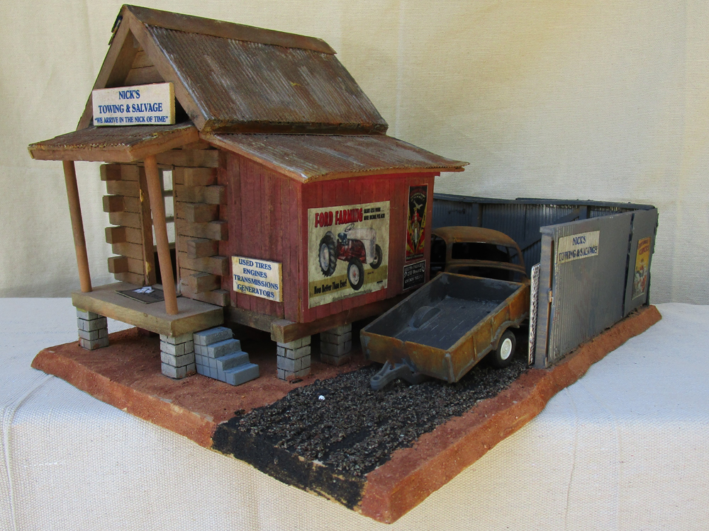 Nick's Towing & Salvage structure made from a wooden birdhouse
