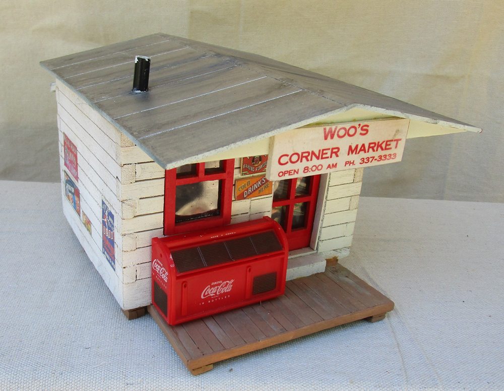 Woo's Corner Market structure made from a wooden birdhouse
