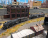 High-angle view of Santa Fe 2-10-2 and 4-8-4 facing left with sand house in foreground and brick car shup in background