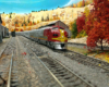 Santa Fe F3 diesels in red and silver warbonnet scheme pull stainless stee passenger traind toward right along two-track main line through western mountain scene in fall