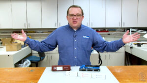 Cody Grivno in Model Railroader workshop with Atlas GP38-2, Accurail 50-foot boxcar, JRT Model Trains 53-foot container