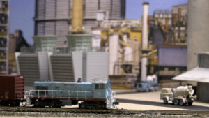 A locomotive sits parked in an industrial scenes
