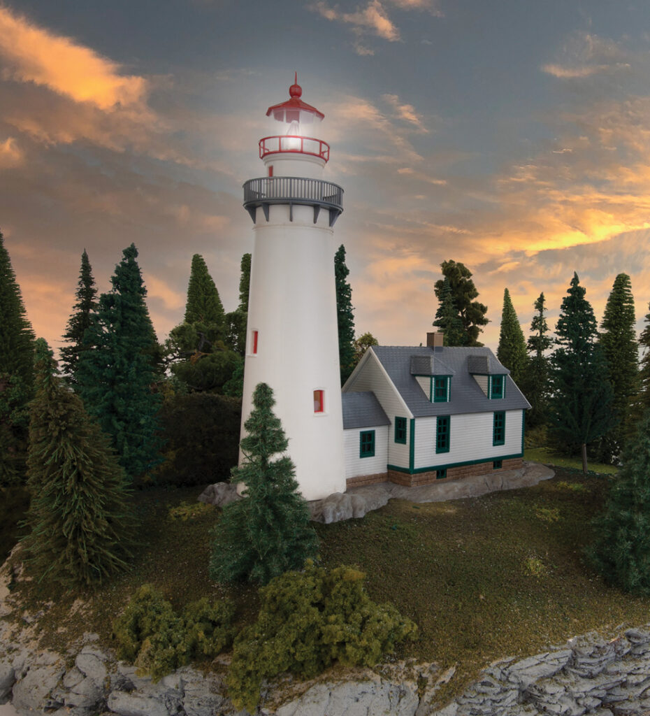 Model lighthouse surrounded by trees