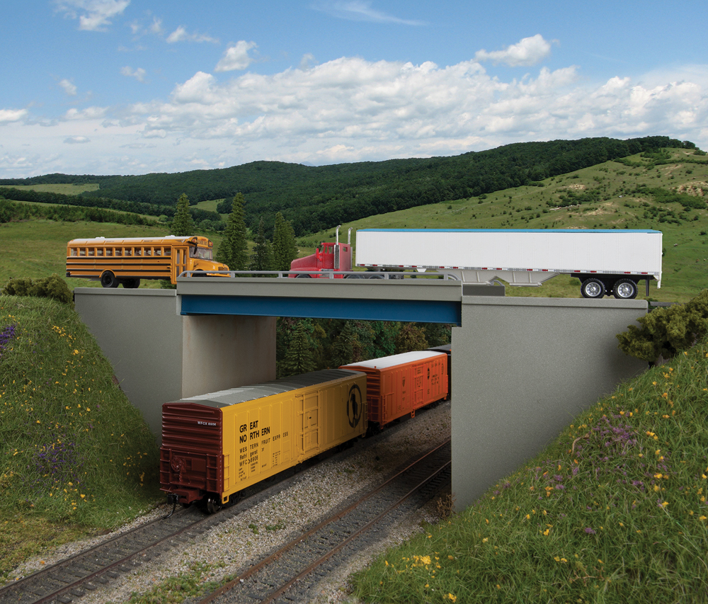 Highway overpass with a train car passing underneath