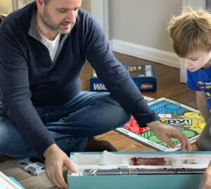 Xavier Turlan unboxing a train with his son Gabriel