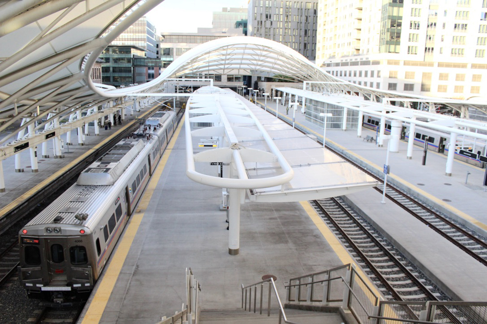 Electrified commuter train at station platform
