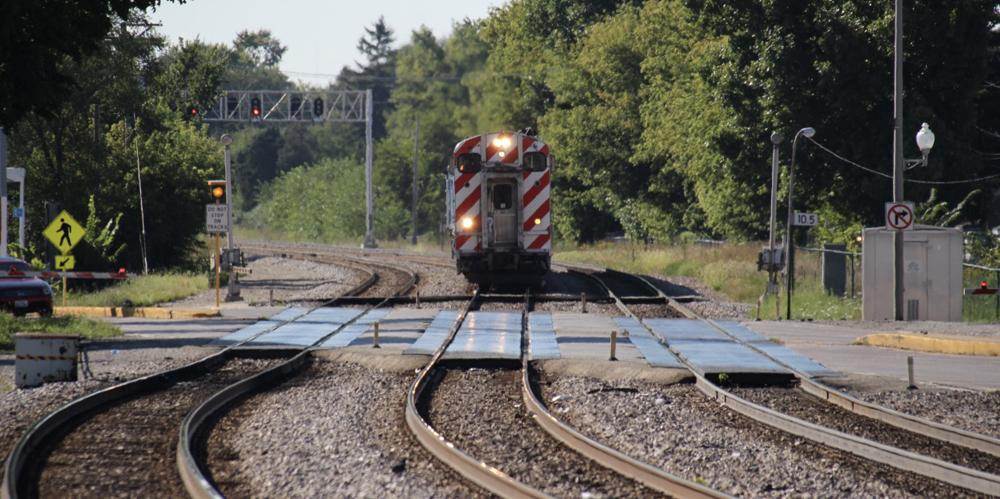 Commuter train approaching grade crossing