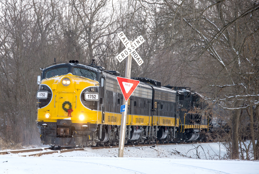 Train approaches grade crossing in snow