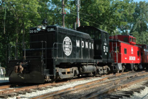 Black switch engine with red caboose