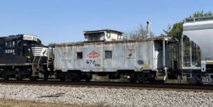 Caboose in middle of freight train