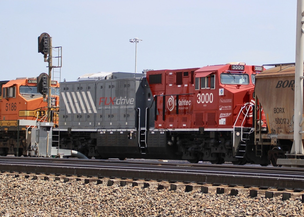 Red and gray battery-electric locomotive