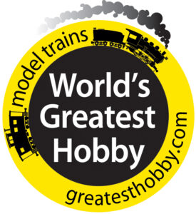 Yellow-black World's Greatest Hobby logo featuring an illustrated steam locomotive and caboose.