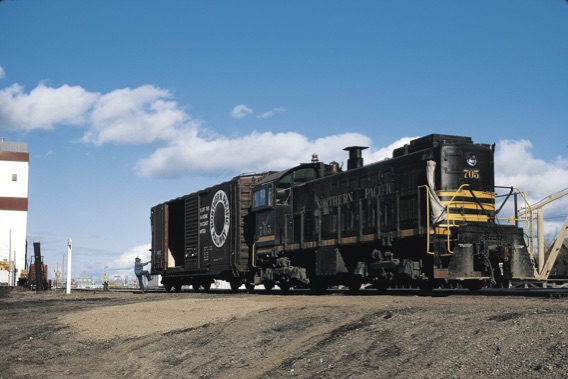 Black diesel switcher with boxcar