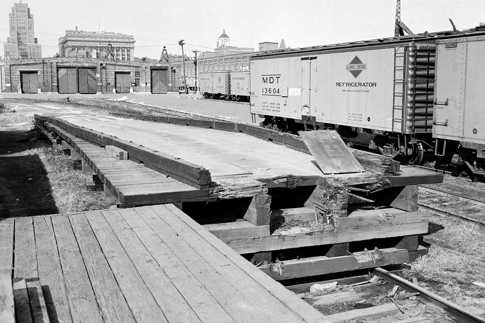 Wooden ramp to load trailers and vehicles onto railroad flatcars