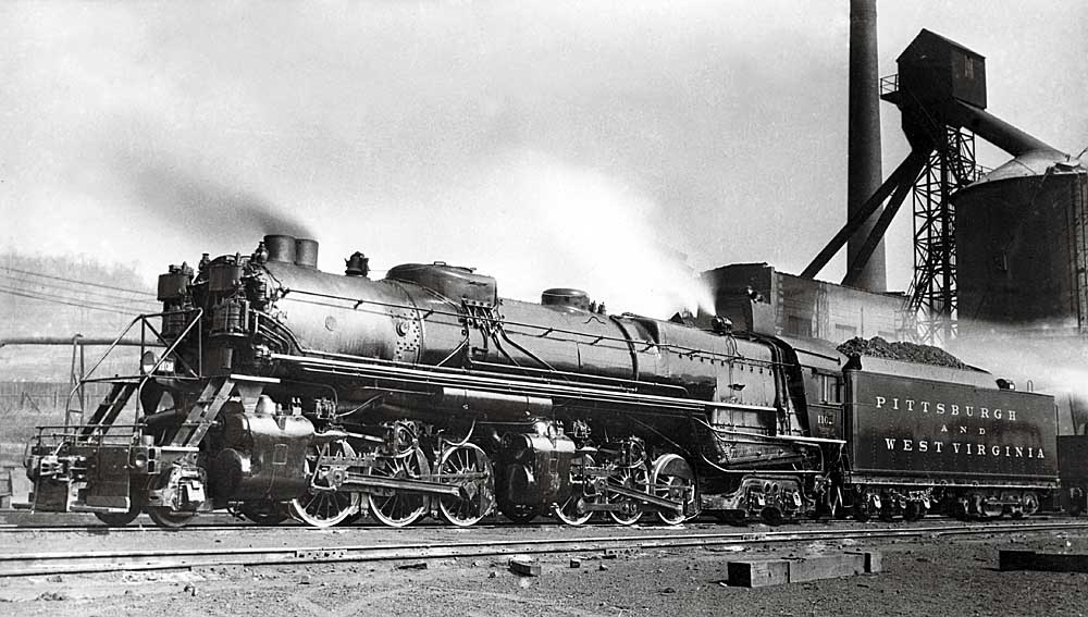Steam locomotive parked by serving facilities