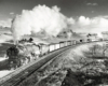 Steam locomotive with freight train.