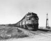 Streamlined diesel locomotives on freight train.